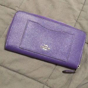 NWOT Purple Coach zip around wallet